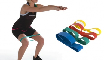 girl working out with resistance band image